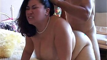 Asian plumper plays with her desirable ass