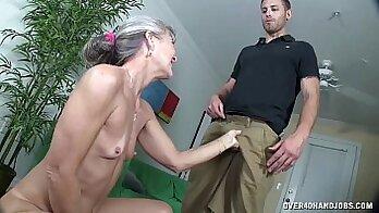 Cocksucking granny plays with a dildo