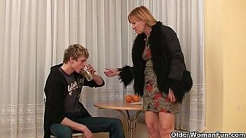 Cock crazed granny Holly enjoys sex act with two hard guys