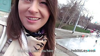 Jazzy babe gives her hairy pussy and pissies in public